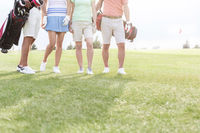 Popular : Low section of friends standing at golf course