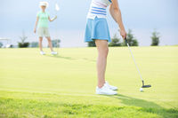 Popular : Low section of woman playing golf with female friend