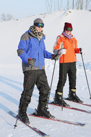 Man and woman skiing