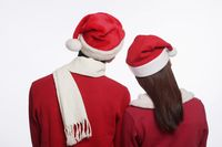 Man and woman with santa hat