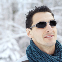 Man in warm clothing and sunglasses