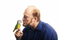 Man kissing bird