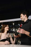 Man recommending good wine to woman