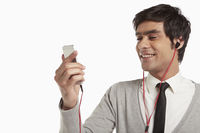 Man smiling and using mobile phone