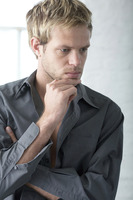 Popular : Man touching his chin while thinking