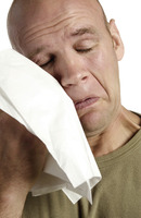 Popular : Man wiping his tears with a tissue