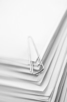 Paper clip on a stack of papers