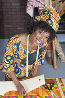 Portrait of an african american female fashion designer working on fabric