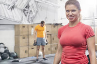 Popular : Portrait of happy woman standing in crossfit gym