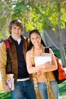 Portrait of two smiling college students outdoors