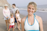 Portrait of woman on beach with family