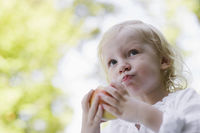Portrait of young girl 91-2  eating apple