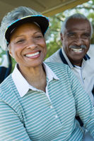 Senior couple in golf course smiling  portrait