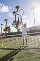 Popular : Senior male tennis player playing on court