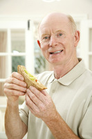 Senior man with a sandwich