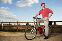 Popular : Senior man with safety helmet sitting on a bicycle
