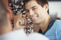 Smiling businessman listening to colleague in meeting
