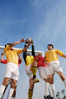 Soccer players jumping for ball low angle view