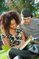 Student couple studying outdoors