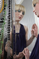 Popular : Teenage girl  16-17  in elegant dress reflected in mirror