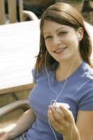 Teenage girl listening to music on a portable mp3 player