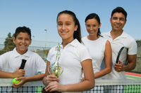 Popular : Tennis family on court by net daughter holding trophy portrait