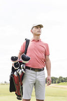 Popular : Thoughtful middle-aged man looking away while carrying golf bag against clear sky