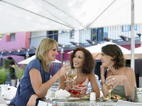 Three female friends at outdoor cafe
