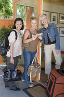 Popular : Three women with luggage on vacation portrait