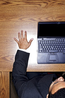 Top angle view of businessman using the laptop