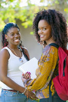 Two female students smiling outdoors  portrait