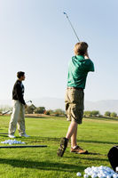 Popular : Two man practising at golf course