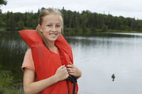 Usa alaska teenage girl wearing life jacket by lake portrait