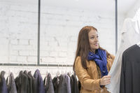 Woman analyzing top in store