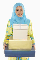 Popular : Woman carrying a stack of gift boxes