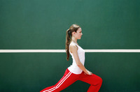 Woman exercising in the tennis court