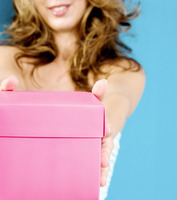Woman holding a pink box