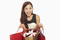 Woman holding a shopping bag with gift box inside