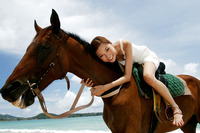 Woman horse riding on the beach