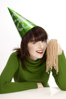 Woman in party hat holding licorice