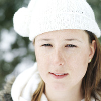 Woman in white knitted hat