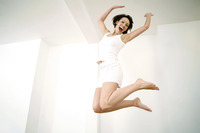 Woman jumping up in joy
