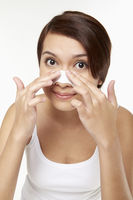 Popular : Woman placing cleansing strip on nose
