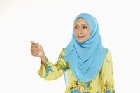 Popular : Woman pointing using her thumb
