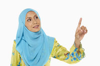 Popular : Woman pointing using index finger