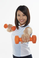 Popular : Woman stretching using dumbbells