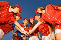 Women s softball team in huddle low angle view