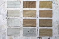 Wood samples on weathered wall