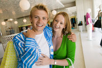 Popular : Young couple shopping in clothing store together portrait