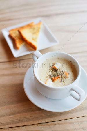 First : A bowl of soup with toast for breakfast